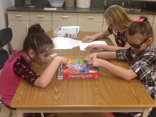 Students playing Hi-Ho Cherry-O