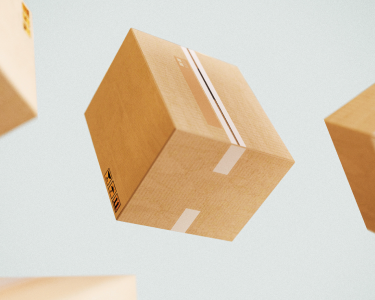 Cardboard boxes falling through the air against a gray background.
