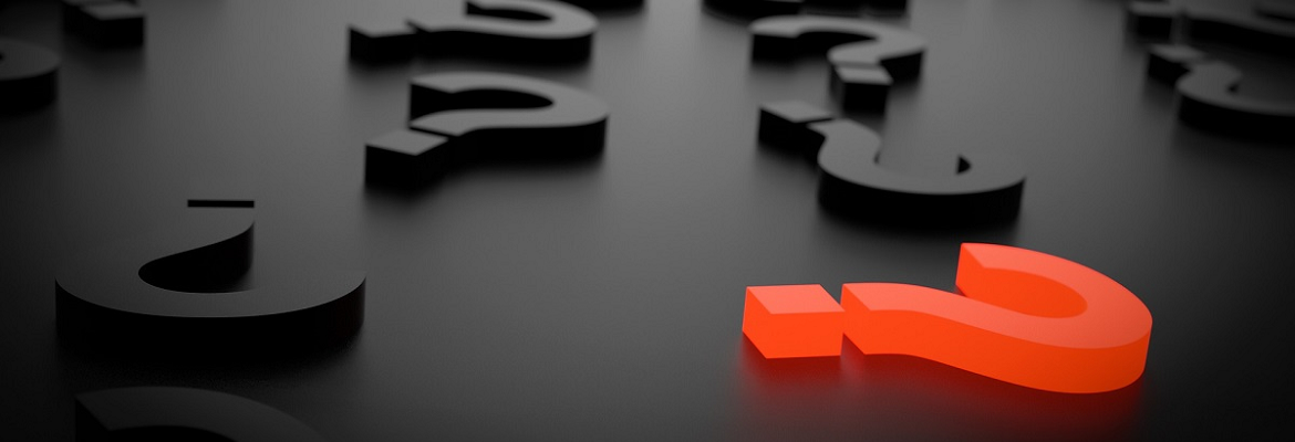 Illustration of a red question mark block surrounded by black question mark blocks resting on a dark surface.