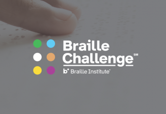 The Braille Challenge logo over a closeup of a person's fingers reading braille.