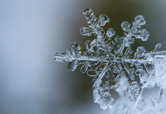 Extreme closeup of a snowflake on a winter day.