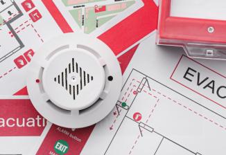 A fire evacuation plan, fire alarm, and smoke detector.