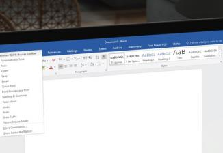 Closeup of a laptop displaying a Word document with the Quick Access Toolbar open.