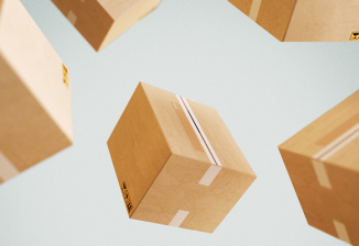 Cardboard boxes falling against a gray background.