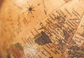 Closeup of a world globe in brown tones.